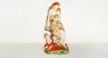 French hand-painted porcelain angel picking flower